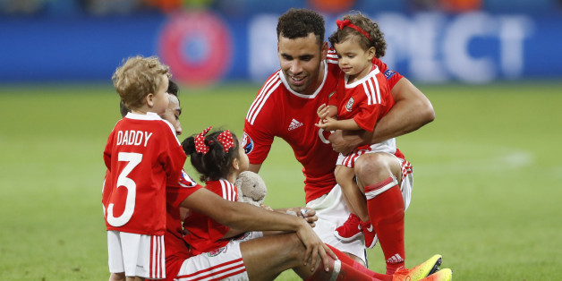 Football Soccer - Wales v Belgium - EURO 2016 - Quarter Final - Stade Pierre-Mauroy, Lille, France - 1/7/16Wales' Hal Robson-Kanu and Neil Taylor celebrate with children at full timeREUTERS/Carl RecineLivepic