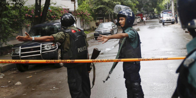 Bangladeshi policemen clear out an area to facilitate action against heavily armed militants who struck at the heart of Bangladesh's diplomatic zone on Friday night, taking dozens of hostages at a restaurant popular with foreigners, Dhaka, Bangladesh, Saturday, July 2, 2016. Police sustained casualties and dozens of people were wounded in a gun battle as security forces cordoned off the area and sought to end the standoff. (AP Photo)