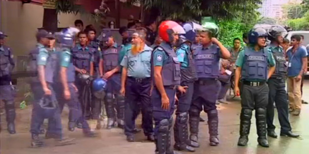 Police gather after gunmen attacked the Holey Artisan restaurant and took hostages early on Saturday, in Dhaka, Bangladesh in this still frame taken from live video July 2, 2016. REUTERS/REUTERS TV