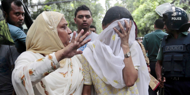 A relative tries to console Semin Rahman, covering face, whose son is missing after militants took hostages in a restaurant popular with foreigners in Dhaka, Bangladesh, Saturday, July 2, 2016. Bangladeshi forces stormed the Holey Artisan Bakery in Dhaka's Gulshan area where heavily armed militants held dozens of people hostage Saturday morning, rescuing some captives including foreigners at the end of the 10-hour standoff. (AP Photo)