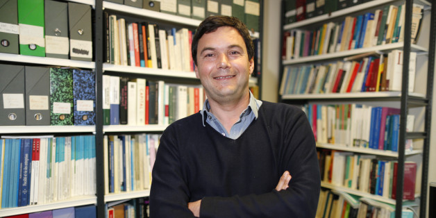 """French economist and academic Thomas Piketty, poses in his book-lined office at the French School for Advanced Studies in the Social Sciences (EHESS), in Paris May 12, 2014. The 43-year-old Piketty's book """"Capital in the Twenty-First Century"""" has attracted praise and invective alike on its way to the top of the Amazon.com books best-seller list. Picture taken May 12, 2014.  REUTERS/Charles Platiau (FRANCE - Tags: POLITICS SOCIETY BUSINESS EDUCATION)"""