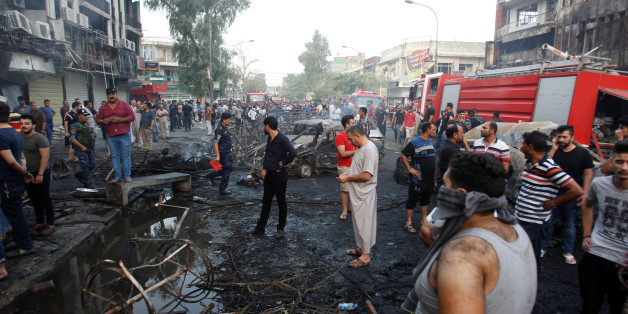 People gather at the site of a suicide car bomb in the Karrada shopping area, in Baghdad, Iraq July 3, 2016. REUTERS/Khalid al Mousily