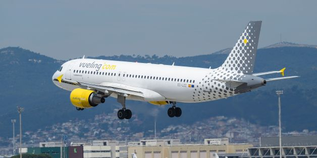 An airplane of the Spanish low-cost airline Vueling lands at Barcelona's airport in El Prat de Llobregat on June 6, 2016. / AFP / JOSEP LAGO        (Photo credit should read JOSEP LAGO/AFP/Getty Images)