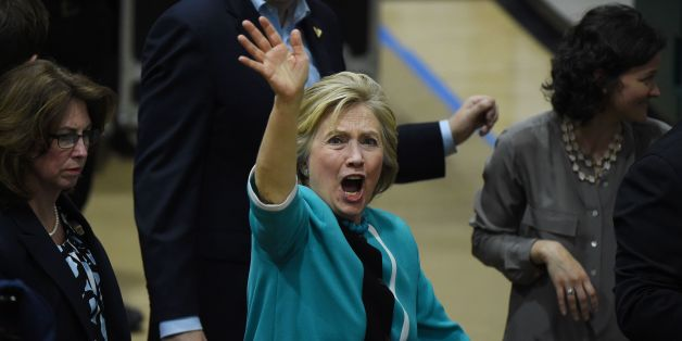 US Democratic presidential candidate Hillary Clinton acknowledges the crowd after a rally at the East Los Angeles College in Monterey Park, California, on May 5, 2016.Close aides to Clinton including longtime confidante Huma Abedin have been interviewed by the FBI as part of its investigation into the ex-secretary of state's use of a private email server, CNN reported Thursday. / AFP / Mark Ralston        (Photo credit should read MARK RALSTON/AFP/Getty Images)