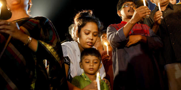 DHAKA, BANGLADESH - 2016/07/03: A boy with his family attends a candle-light ceremony to pay tribute to the people who have been killed in a terrorists attack at the Holey Artisan Bakery, in Dhaka,
