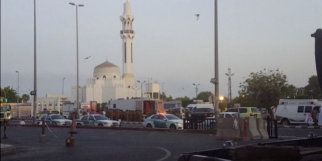 General view of security personnel in front of a mosque as police stage a second controlled explosion, after a suicide bomber was killed and two other people wounded in a blast near the U.S. consulate in Jeddah, Saudi Arabia, in this still frame taken from video July 4, 2016. REUTERS/REUTERS TV     TPX IMAGES OF THE DAY
