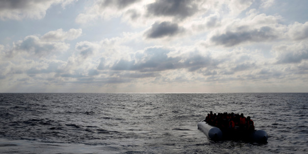 Migrants in a dinghy await rescue by the Migrant Offshore Aid Station (MOAS) around 20 nautical miles off the coast of Libya, June 23, 2016.  Picture taken June 23, 2016. REUTERS/Darrin Zammit Lupi MALTA OUT. NO COMMERCIAL OR EDITORIAL SALES IN MALTA  TPX IMAGES OF THE DAY