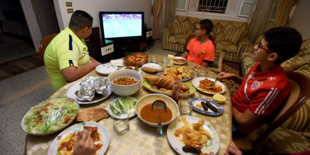 A Tunisian family watches a Euro 2016 football match during the break of Ramadan fast on June 17, 2016 in Tunis. / AFP / FETHI BELAID        (Photo credit should read FETHI BELAID/AFP/Getty Images)