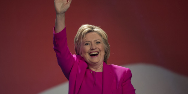 Democratic presidential candidate Hillary Clinton waves as she arrives to address the The National Education Association (NEA) Representative Assembly in Washington D.C., Tuesday, July 5, 2016. FBI Director James Comey said Tuesday, the FBI will not recommend criminal charges in its investigation into Hillary Clinton's use of a private email server while secretary of state. (AP Photo/Molly Riley)