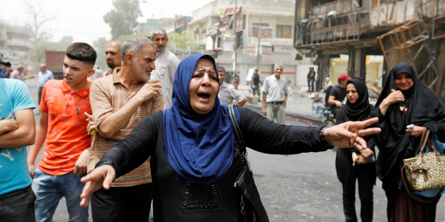 A woman reacts at the site after a suicide car bomb attack at the shopping area of Karrada, a largely Shi'ite district, in Baghdad, Iraq July 4, 2016. REUTERS/Ahmed Saad