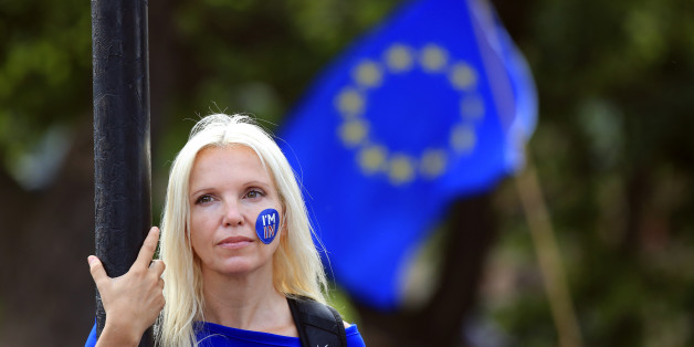 A woman stands still during a 'March for Europe' demonstration against Britain's decision to leave the European Union, in central London, Britain July 2, 2016. Britain voted to leave the European Union in the EU Brexit referendum.      REUTERS/Paul Hackett