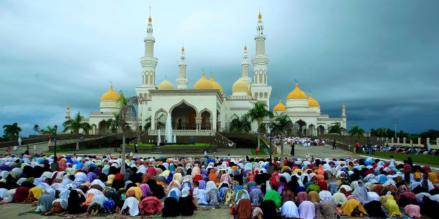CORRECTION - Filipino Muslims participate in morning prayers as they celebrate Eid al-Fitr at the Sultan Hassanal Bolkiah Grand Mosque in the Philippine city of Cotabato on July 6, 2016.  Muslims across the world are celebrating the annual festival of Eid al-Adha, or the festival of sacrifice, which marks the end of the Hajj pilgrimage to Mecca and commemorates Prophet Abraham's readiness to sacrifice his son to show obedience to God. / AFP / MARK NAVALES / The erroneous mention[s] appearing in the metadata of this photo by MARK NAVALES has been modified in AFP systems in the following manner: [Cotabato] instead of [Maguindanao]. Please immediately remove the erroneous mention[s] from all your online services and delete them from your servers. If you have been authorized by AFP to distribute them to third parties, please ensure that the same actions are carried out by them. Failure to promptly comply with these instructions will entail liability on your part for any continued or post notification usage. Therefore we thank you very much for all your attention and prompt action. We are sorry for the inconvenience this notification may cause and remain at your disposal for any further information you may require.        (Photo credit should read MARK NAVALES/AFP/Getty Images)