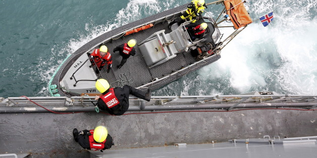 Icelandic coast guards prepare to patrol on a rubber dinghy from the vessel Tyr as they sail to off the eastern coast of Sicily March 17, 2015. The vessel Tyr is part of the EU border agency Frontex mission named Triton. With migration across the Mediterranean surging, the European Union's largest border operation is bracing for a record year of arrivals by sea, especially as summer brings calm waters between Italy and Libya. Picture taken March 17, 2015.    REUTERS/Alessandro Bianchi