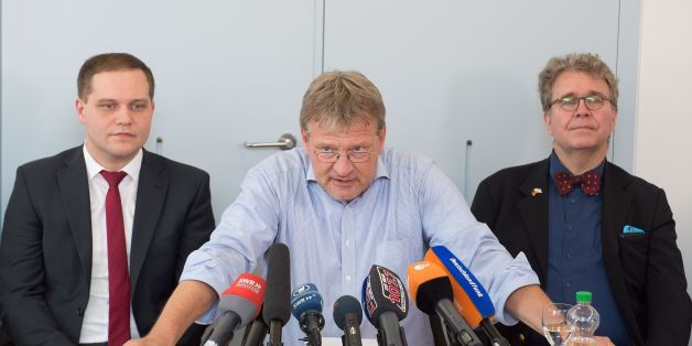 Joerg Meuthen (C), parliamentary group leader of the right-wing populist party AfD (Alternative for Germany) in the regional parliament of Baden-Wuerttemberg, southern Germany, is flanked by AfD parliamentary group members Anton Baron (L) and Heinrich Fiechtner as he gives a press conference on July 5, 2016 at the regional parliament in Stuttgart.