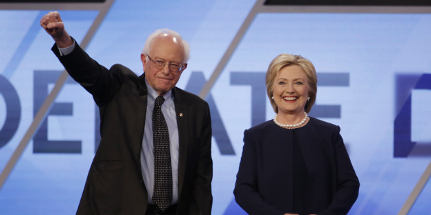 Democratic U.S. presidential candidates Senator Bernie Sanders and Hillary Clinton pose before the start of the Univision News and Washington Post Democratic U.S. presidential candidates debate in Kendall, Florida March 9, 2016.   REUTERS/Carlo Allegri