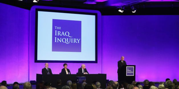 Iraq Inquiry chairman Sir John Chilcot (R) speaks as he comments on the findings of his report, inside the QEII Centre in London on July 6, 2016.Britain's then prime minister Tony Blair promised US George W. Bush in 2002 that he would be with him on Iraq 'whatever' happened, nearly a year before the invasion, Britain's Iraq War Inquiry report said on Wednesday. The decision to join the US-led invasion in 2003 on the basis of flawed intelligence, the occupation and Iraq's bloody descent into sect