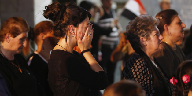 Iraqi Christians react during a mass for the victims of Sunday's truck bomb attack in Karada neighborhood in Baghdad, at St. Trazia Church in Basra, 340 miles (550 kilometers) southeast of Baghdad, Iraq, Wednesday, July 6, 2016. (AP Photo/Nabil al-Jurani)