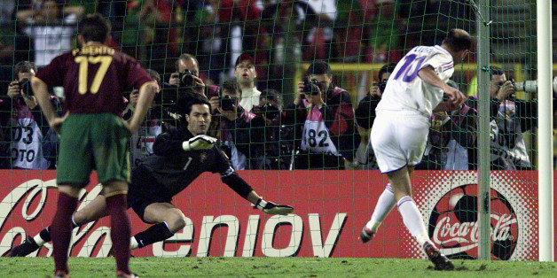 France's Zinedine Zidane (R) scores his extra time golden penalty goal against Portugal's goal keeper Vitor Baia (C) as his team mate Paulo Bento (L) looks on in their European championship semi-finals June 28. France wins 2-1 and will go on to play in the finals.JL/JES