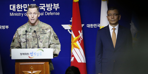 Lt. Gen. Thomas Vandal, the commander of U.S. Forces Korea's Eighth Army, center, speaks to the media about deploying the Terminal High-Altitude Area Defense, or THAAD as South Korean Defense Ministry's deputy minister for policy Yoo Jeh-seung, right, listens during a media briefing at the Defense Ministry in Seoul, South Korea, Friday, July 8, 2016. (AP Photo/Lee Jin-man)
