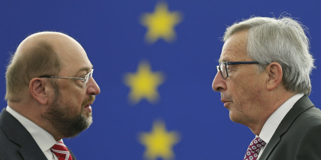 European Commission President Luxembourg Jean-Claude Juncker (R) talks to European Parliament President Martin Schulz as he arrives to address the European Parliament to present a plan on growth, jobs and investment, in Strasbourg, November 26, 2014. Juncker presented a plan on Wednesday to leverage some 300 billion euros ($375 billion) of largely private new investment in the European Union, saying it was time to kick-start growth without adding to public debt.   REUTERS/Vincent Kessler (FRANCE