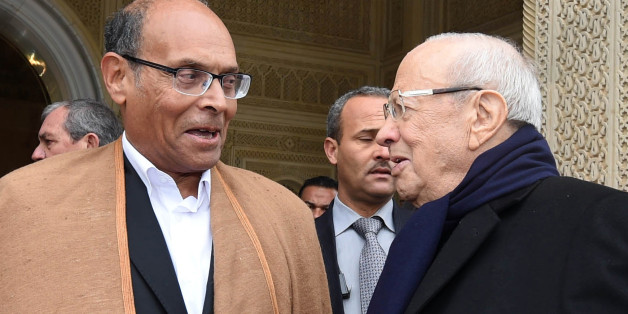Tunisia's new President, Beji Caid Essebsi, right, shakes hands with out-going President, Moncef Marzouki, during a handover ceremony at the presidential palace in Carthahe outside Tunis, Tunisia, Wednesday, Dec. 31, 2014. Tunisia's new president pledged a rule of reconciliation and consensus as he took his oath Wednesday before the newly elected parliament to complete the country's democratic transition. The inauguration of Beji Caid Essebsi, an 88-year-old political veteran, comes in a year in