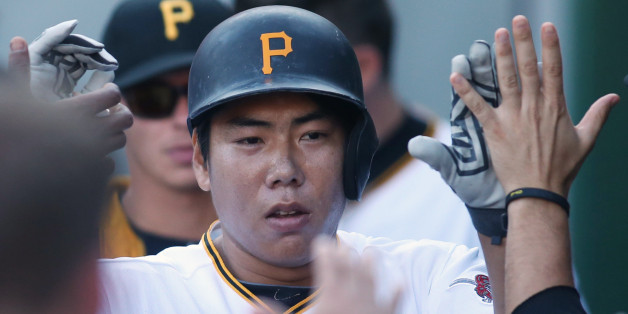 Aug 22, 2015; Pittsburgh, PA, USA; Pittsburgh Pirates shortstop Jung Ho Kang (27) is greeted in the dugout after hitting his second solo home run of the game against the San Francisco Giants during the seventh inning at PNC Park. The Pirates won 3-2. Mandatory Credit: Charles LeClaire-USA TODAY Sports