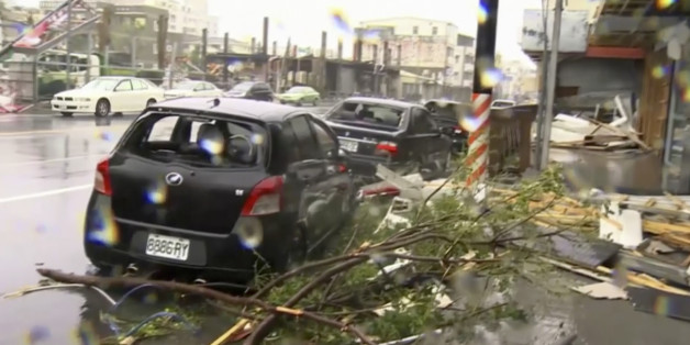 In this image made from video, wind-blown debris from Typhoon Nepartak litters the street and damages a vehicle in Taitung, south eastern Taiwan, Friday, July 8, 2016. Power was partially restored in Taiwan on Friday after Nepartak slammed into the island's eastern coast with ferocious winds and torrential rains. (EBC via AP Video)