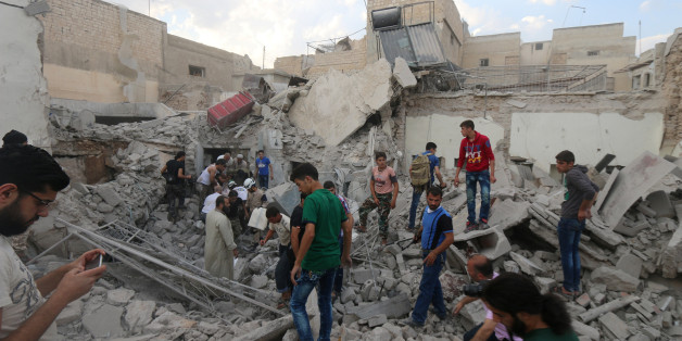 Men look for survivors under the rubble of a damaged building after an airstrike on Aleppo's rebel held Kadi Askar area, Syria July 8, 2016. REUTERS/Abdalrhman Ismail