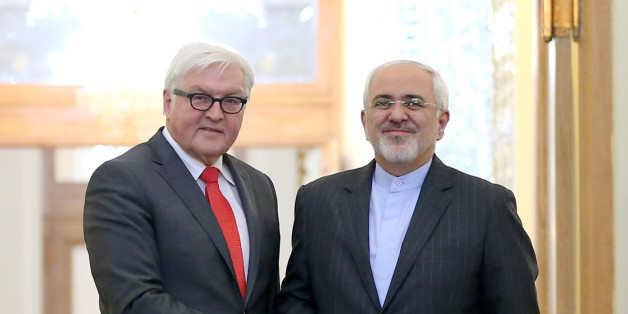 Iranian Foreign Minister Mohammad Javad Zarif, right, and his German counterpart Frank-Walter Steinmeier shake hands as they pose for photos at the end of their press conference in Tehran, Iran, Tuesday, Feb. 2, 2016. (AP Photo/Ebrahim Noroozi)