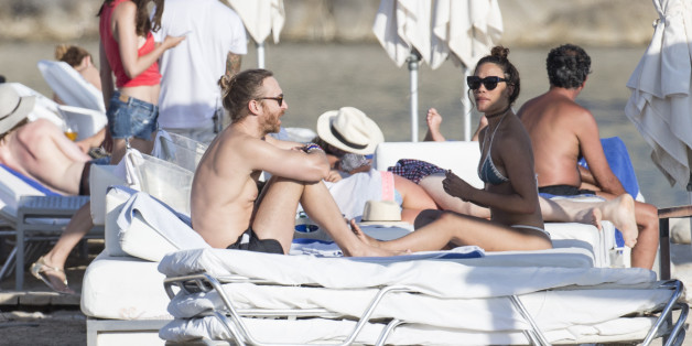 IBIZA, SPAIN - JULY 06: David Guetta and girlfriend enjoy a day at a beach club on July 6, 2016 in Ibiza, Spain. (Photo by Iconic/GC Images)