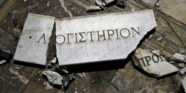 """A broken marble sign that reads """"Accountant's Office"""" lies on the floor of a deserted marble factory that closed in 2006 near the town of Larissa in Thessaly region, Greece April 22, 2015. As Athens faces growing pressure to reach agreement with lenders to avoid financial chaos, an angry Greek public feels the pain of cuts following a six-year recession, with unemployment more than double the euro zone average. A 2,500 km trip from Athens to northeastern Greece and back via the Peloponnese region in the south shows the remnants of a once-flourishing Greek industry, which has suffered a 30 percent drop in production from its peak. Abandoned factories, previously making goods from timber to textiles and cooking oil, are often looted, adding to the scenes of desolation. REUTERS/Yannis Behrakis TPX IMAGES OF THE DAY  PICTURE 03 OF 44 FOR WIDER IMAGE STORY """"GHOST FACTORIES OF GREECE""""  SEARCH """"BEHRAKIS FACTORY"""" FOR ALL IMAGES"""
