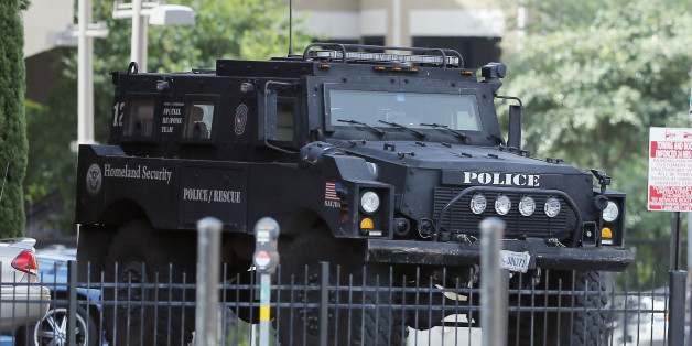 A Homeland Security tactical vehicle sits in the crime scene area of Thursday night shooting, Sunday, July 10, 2016, in Dallas. Micah Johnson, the suspect in the deadly attack on Dallas police taunted authorities during two hours of negotiations, laughing at them, singing and at one point asking how many officers he had shot, the police chief said Sunday. (AP Photo/Tony Gutierrez)