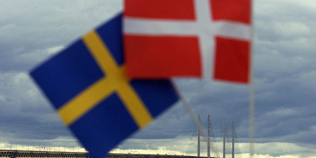 Swedish (L) and Danish flags are seen near the Oresund Bridge July 1. The bridge-tunnel link between Denmark and Sweden was inaugurated Saturday by Queen Margrethe II of Denmark and King Carl XVI Gustaf of Sweden. The rail-and-road link connects the Danish capital Copenhagen with southern Sweden across the 16-kilometer wide Oresund strait.