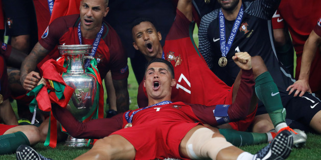 Football Soccer - Portugal v France - EURO 2016 - Final - Stade de France, Saint-Denis near Paris, France - 10/7/16Portugal's Cristiano Ronaldo celebrates with Ricardo Quaresma, Nani, Rui Patricio and the trophy after winning Euro 2016 REUTERS/Carl RecineLivepic     TPX IMAGES OF THE DAY