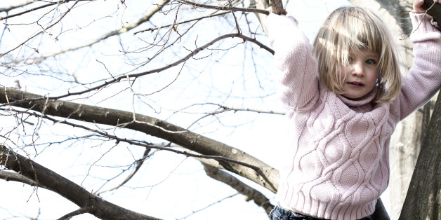 Girl playing on tree