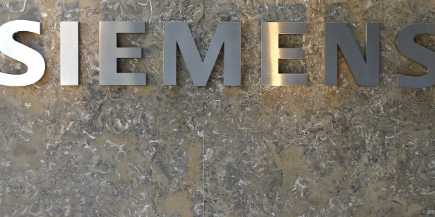 The logo of German industrial conglomerate Siemens is pictured prior to opening ceremony at the new headquarters in Munich, Germany, Friday, June 24, 2016. (AP Photo/Matthias Schrader)