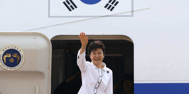 South Korean President Park Geun-hye waves as she embarks an airplane at the Seoul Air Base of South Korean air force in Seongnam, south of Seoul June 27, 2013, before she leaves for China. Park will arrive in Beijing on Thursday for her four-day state visit and will hold her first summit with Chinese President Xi Jinping.   REUTERS/Lee Jae-Won (SOUTH KOREA - Tags: POLITICS)