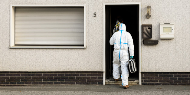 FILE - In this Nov. 13, 2015 file picture a police investigator in protective cloth enters a house in Wallenfels, southern Germany,  where police found bodies of multiple babies. A couple have gone on trial  Tuesday July 12, 2016 in Germany after the remains of eight babies were found at their apartment in Bavaria last year. The 45-year-old mother, identified only as Andrea G., is charged with four counts of murder in the trial at the Coburg state court and her 55-year-old husband, Johann G., wi