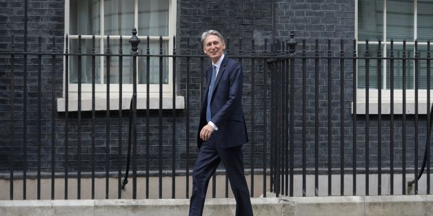 British Foreign Secretary Philip Hammond walks to 10 Downing Street in central London on July 13, 2016 after New British Prime Minister Theresa May takes office following the formal resignation of David Cameron.  Theresa May took office as Britain's second female prime minister on July 13 charged with guiding the UK out of the European Union after a deeply devisive referendum campaign ended with Britain voting to leave and David Cameron resigning.   / AFP / OLI SCARFF        (Photo credit should read OLI SCARFF/AFP/Getty Images)