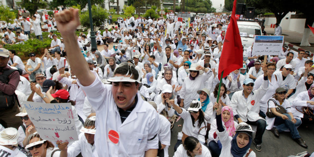 Teachers of public medical schools, accompanied by hundreds of students, demonstrate to prohibit the upcoming opening of private medical schools in Rabat May 25, 2011.    REUTERS/Youssef Boudlal (MOROCCO - Tags: HEALTH POLITICS CIVIL UNREST)