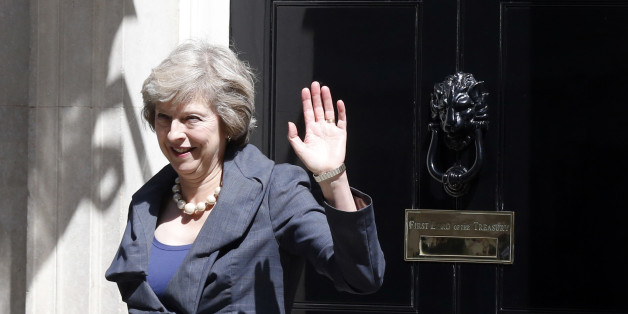 Britain's Home Secretary Theresa May, who is due to take over as prime minister on Wednesday, waves as she leaves after a cabinet meeting at number 10 Downing Street, in central London, Britain July 12, 2016.         REUTERS/Paul Hackett