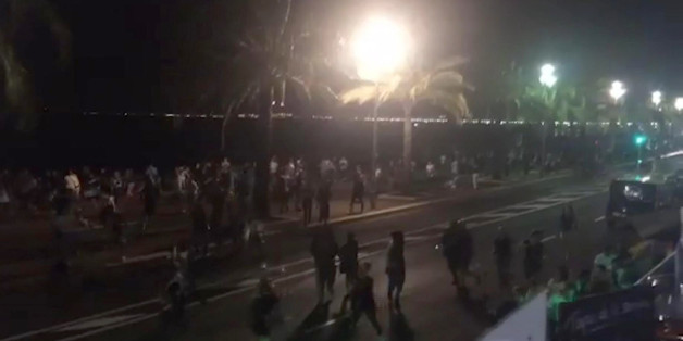 In this UGC video grab provided by Harp Detective on Thursday July 14, 2016, people run out from the scene after a truck drove on to the sidewalk and plowed through a crowd of revelers who'd gathered to watch the fireworks in the French resort city of Nice. Officials and eyewitnesses described as a deliberate attack. There appeared to be many casualties. (Harp Detective via AP)