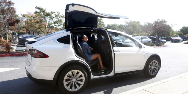 A Tesla Model X picks up passengers during a Tesla event in Palo Alto, California October 14, 2015. REUTERS/Beck Diefenbach
