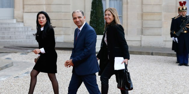 Tunisia's ambassador to France, Mohamed Ali Chihi (C) and President of France Medias Monde (FMM) Marie-Christine Saragosse (R) arrive for a state dinner in honor of the Tunisian President on April 7, 2015 at the Elysee palace in Paris. Tunisian President Beji Caid Essebsi started on April 7 a two-day visit to France.  AFP PHOTO / THOMAS SAMSON        (Photo credit should read THOMAS SAMSON/AFP/Getty Images)