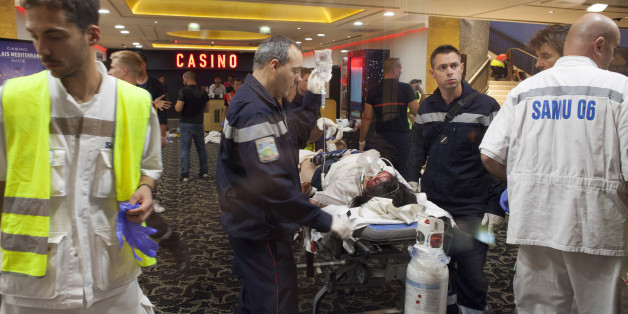 NICE, FRANCE - JULY 14:  Victims are given medical assistance at Casino Du Palais De La Mediterranee, following a truck attack on Promenade des Anglais on July 14, 2016 in Nice, France. A French-Tunisian attacker killed 84 people as he drove a truck through crowds, gathered to watch a firework display during Bastille Day celebrations. The attacker then opened fire on people in the crowd before being shot dead by police. (Photo by Remi Benali/Getty Images)