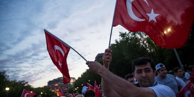 WASHINGTON, USA - JULY 15: Turks and other supporters gather in front of the White House to protest the attempted military coup in Turkey over night in Washington, USA on July 15, 2016. (Photo by Samuel Corum/Anadolu Agency/Getty Images)