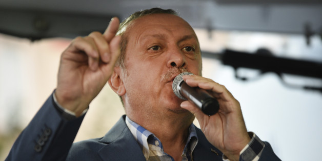 Turkish President Recep Tayyip Erdogan delivers a speech in Istanbul, Saturday, July 16, 2016. Forces loyal to Erdogan quashed a coup attempt in a night of explosions, air battles and gunfire that left some hundreds of people dead and scores of others wounded Saturday. The chaos Friday night and Saturday came amid a period of political turmoil in Turkey _ a NATO member and key Western ally in the fight against the Islamic State group _ that critics blame on Erdogan's increasingly authoritarian r