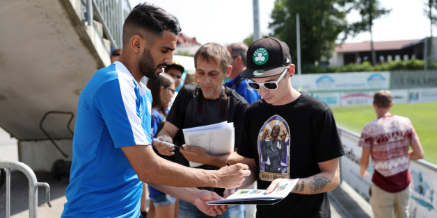 LEICESTER, ENGLAND - JULY 12:  Leicester City's Riyad Mahrez signs autographs during the Leicester City Pre-Season tour of Austria at Stegersbach Training Facility on July 12, 2016 in Stegersbach, Austria.  (Photo by Plumb Images/Leicester City FC via Getty Images)