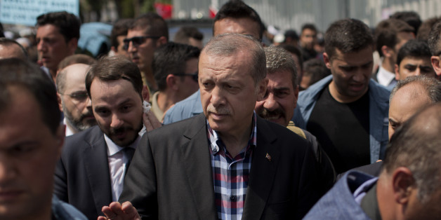Turkish President Recep Tayyip Erdogan leaves the mosque after attending a funeral for people killed Friday while protesting against the attempted coup against Turkey's government, in Istanbul, Sunday, July 17, 2016. Rather than toppling Turkey's strongman president, a failed military coup appears to have bolstered Erdogan's immediate grip on power and boosted his popularity. (AP Photo/Emilio Morenatti)