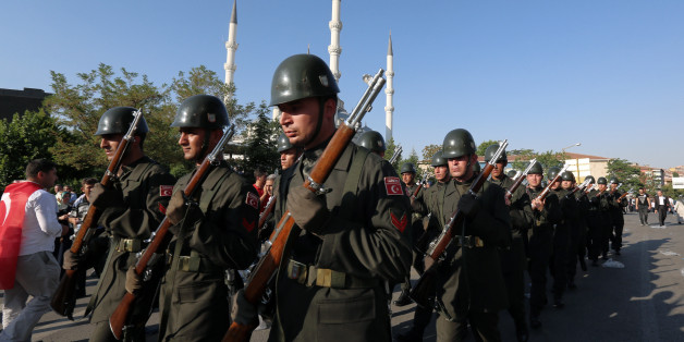 Turkish soldiers march after a mass funeral for the victims of a failed military coup last Friday, outside Kocatepe Mosque in Ankara, Turkey, Sunday, July 17, 2016. The Turkish government accelerated its crackdown on alleged plotters of the failed coup against President Recep Tayyip Erdogan, with the justice minister saying Sunday that 6,000 people had been detained in the investigation, including three of the country's top generals and hundreds of soldiers. (AP Photo/Burhan Ozbilici)